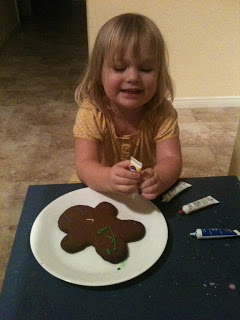 decorating a gluten free gingerbread cookie