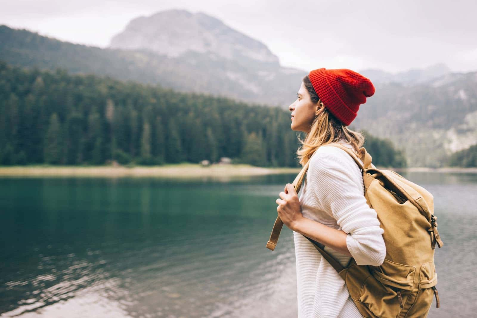 woman travelling solo by a lake