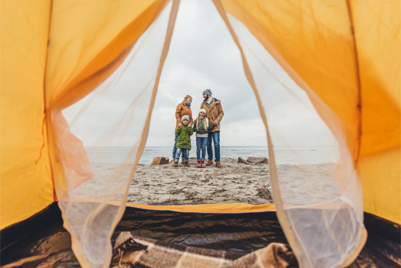 A family backpacking and camping on the beach