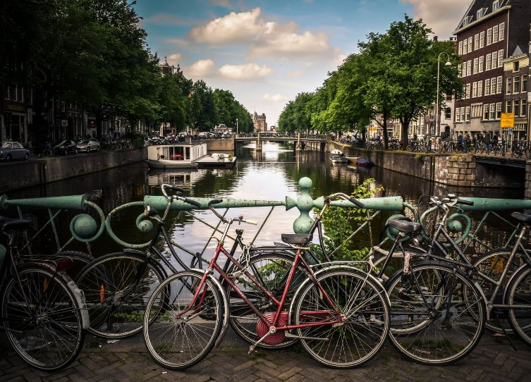 Amsterdam with kids biking the canal